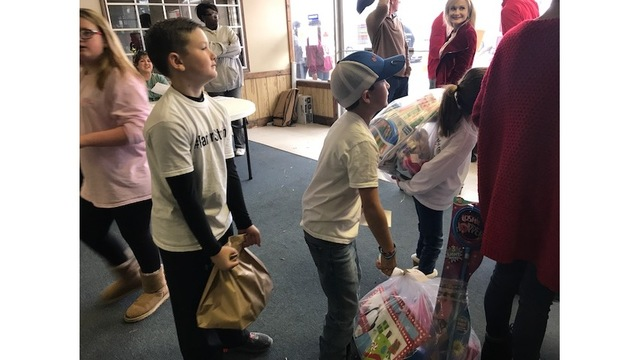 Children in Laurel learn the true meaning of Christmas by giving back